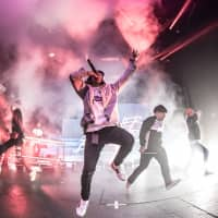 Center stage: 88rising has helped to give exposure to Asian hip-hop artists such as Chinese group Higher Brothers, which recently played in Tokyo. | 88RISING