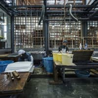 Center of production: Awagami papermakers work on new extra-thick handmade washi for digital printing.
