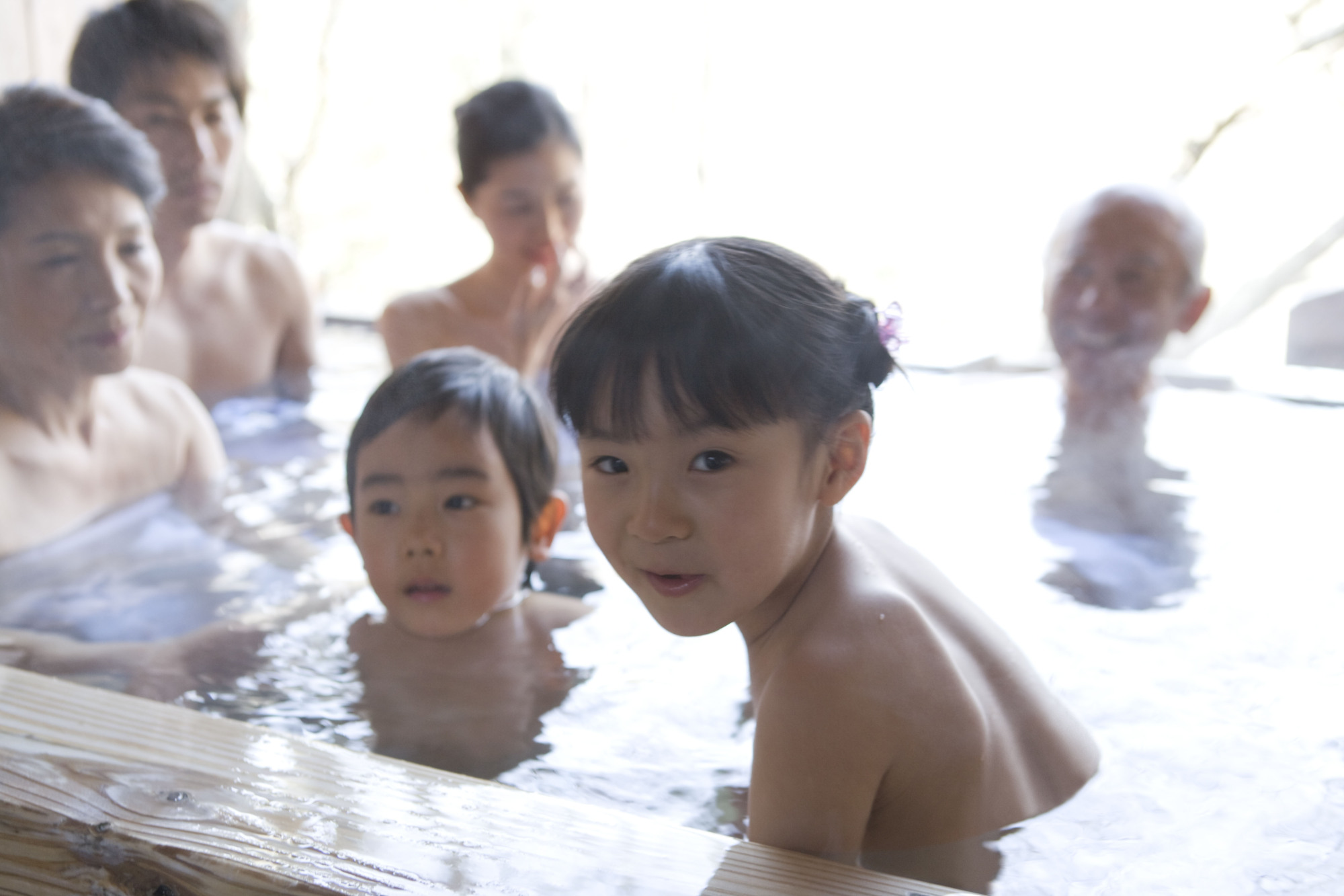Family dip: Japanese spas are great places to take kids to warm up during the cold winter. | GETTY IMAGES
