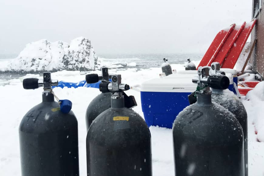 Preparing to dive: Oxygen tanks stacked up on the ice.