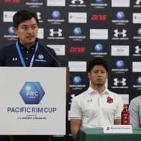 True blue: Takehiko Nakamura makes an announcement at a news conference for the Pacific Rim Cup, which his company, Blue United, launched in Hawaii in 2018. | © BLUE UNITED CORPORATION