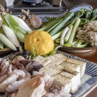 Making hot pot is a group activity: A spread of prepared ingredients for monkfish hot pot, which diners cook themselves at the table. | MAKIKO ITOH