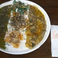 Deal of the day: The Calayer Special Dish comes with two curries and two toppings over 200 grams of rice.   ROSS RANDLES