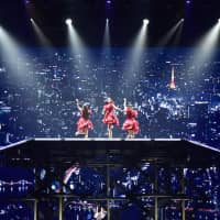 City lights: Perfume's live shows often feature elaborate stage backgrounds. | AZUSA TAKADA