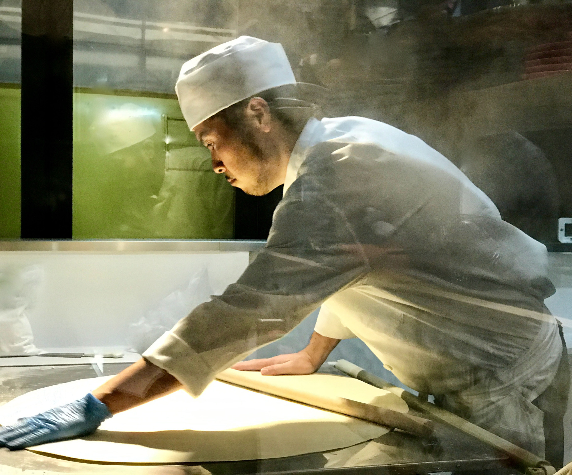 Made to order: A chef rolls out the dough for the udon noodles that fill the bowls at Men Chirashi. | ROBBIE SWINNERTON