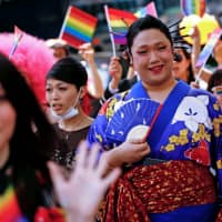 Coming out: People take part in a Tokyo Rainbow Pride parade in 2016. Language is constantly evolving, particularly in the LGBT community. | REUTERS