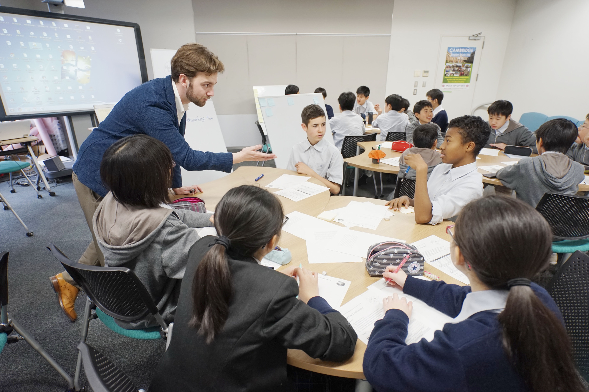 Asking the right questions: Alexander Dutson (left) teaches a class of returnee junior high school students at Kaetsu Ariake in Tokyo. That day's particular lesson was on personal identity and the children were discussing whether they think they remain the same person over time.