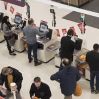 The self-checkout terminal, where customers ring up and bag their own purchases, is an increasingly common form of 'shadow work' that companies impose on their customers. | BLOOMBERG