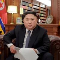 North Korean leader Kim Jong Un sports a new look but delivers an old message in his New Year's Day address on Tuesday. | REUTERS