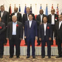 Prime Minister Shinzo Abe and other leaders pose for a group photograph at the PALM 8 Meeting in Iwaki, Fukushima Prefecture, on May 19. | KYODO