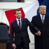 Middle-class French President Emmanuel Macron isn't trusted by society's bottom 50 percent while billionaire U.S. President Donald Trump is. | BLOOMBERG