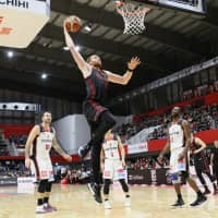 Alex Kirk of the Alvark Tokyo rises to deliver a slam dunk during his team's win over the Osaka Evessa on Sunday in Tachikawa. | B. LEAGUE