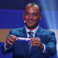 Retired Brazil international Cafu indicates the selection of Japan during the draw event for the 2019 Copa America in Rio de Janeiro. Japan was placed in Group C with Uruguay, Chile, and Ecuador. | REUTERS