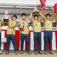 Toyo University runners celebrate after winning Wednesday's leg of the Hakone ekiden. The 2014 champions recorded a time of 5 hours, 26 minutes, 31 seconds. | KYODO