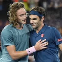 Greece's Stefanos Tsitsipas (left) is congratulated by Switzerland's Roger Federer after winning their fourth-round match on Sunday at the Australian Open in Melbourne. | AP