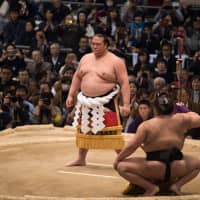 Kisenosato enters the ring as a yokozuna for the first time at the 2017 Osaka Grand Sumo Tournament, which he went on to win despite injury. | JOHN GUNNING