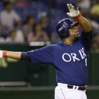 Tuffy Rhodes finished his NPB career with 464 home runs and 1,269 RBIs. | KYODO