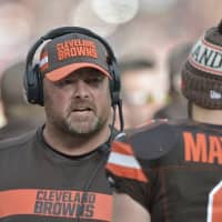 The Cleveland Browns have promoted offensive coordinator Freddie Kitchens, seen here talking with QB Baker Mayfield, to head coach, according to reports on Wednesday. | AP