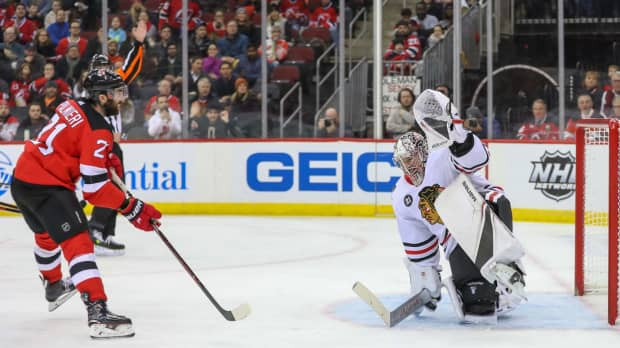 Devils find net five times in second period in wild victory over Blackhawks