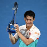 Kei Nishikori celebrates with the winner's trophy after defeating Daniil Medvedev of Russia in the men's singles final match at the Brisbane International on Sunday. | AFP-JIJI