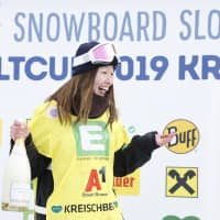 Miyabi Onitsuka poses on the podium after winning the FIS Snowboard Slopestyle World Cup on Saturday in Kreischberg, Austria. | AFP-JIJI
