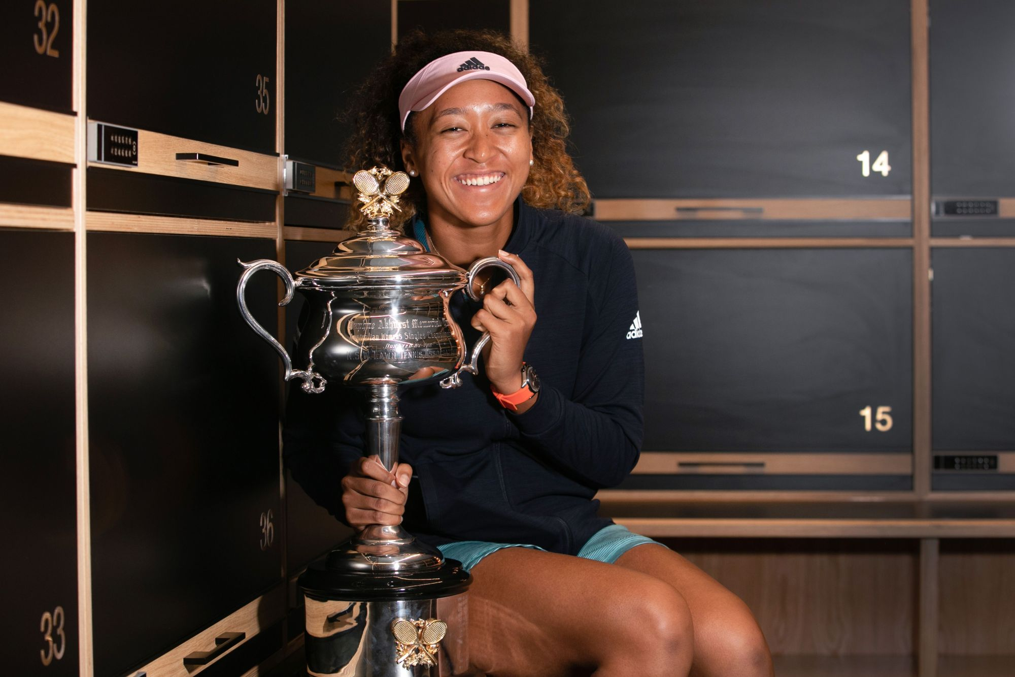 Naomi Osaka poses with the trophy after winning the Australian Open on Saturday in Melbourne, Australia. | AFP-JIJI