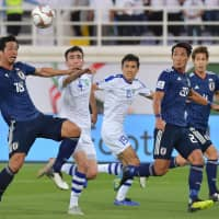 Japan beats Uzbekistan, claims top spot in Group F at Asian Cup