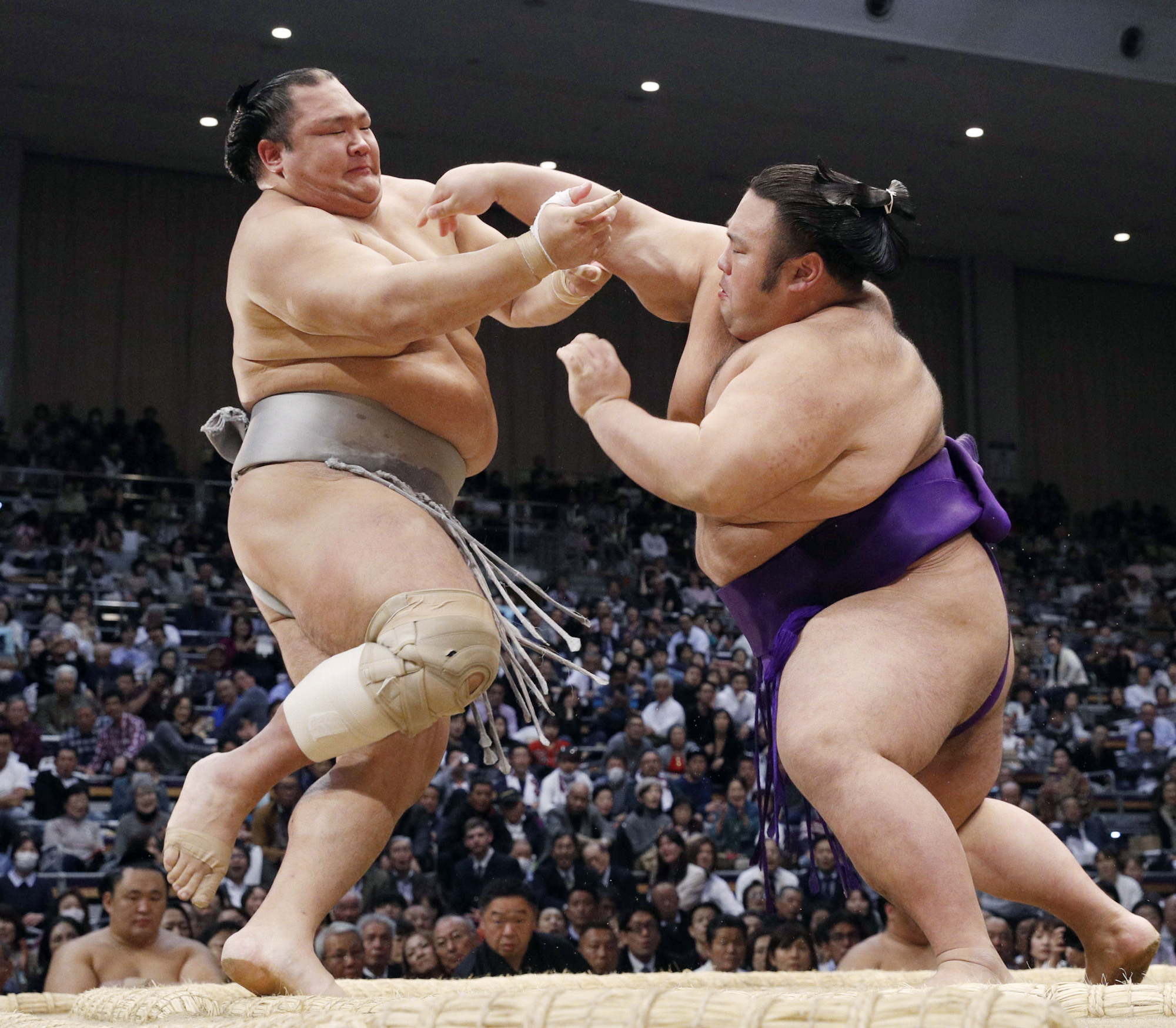Takakeisho (right), seen during the Kyushu Basho last November, is one of sumo's most promising young  talents. | KYODO