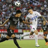 Sagan's Fernando Torres, seen during a match against Grampus on Aug. 19, 2018, in Nagoya, has renewed his contract with the J. League club. | KYODO