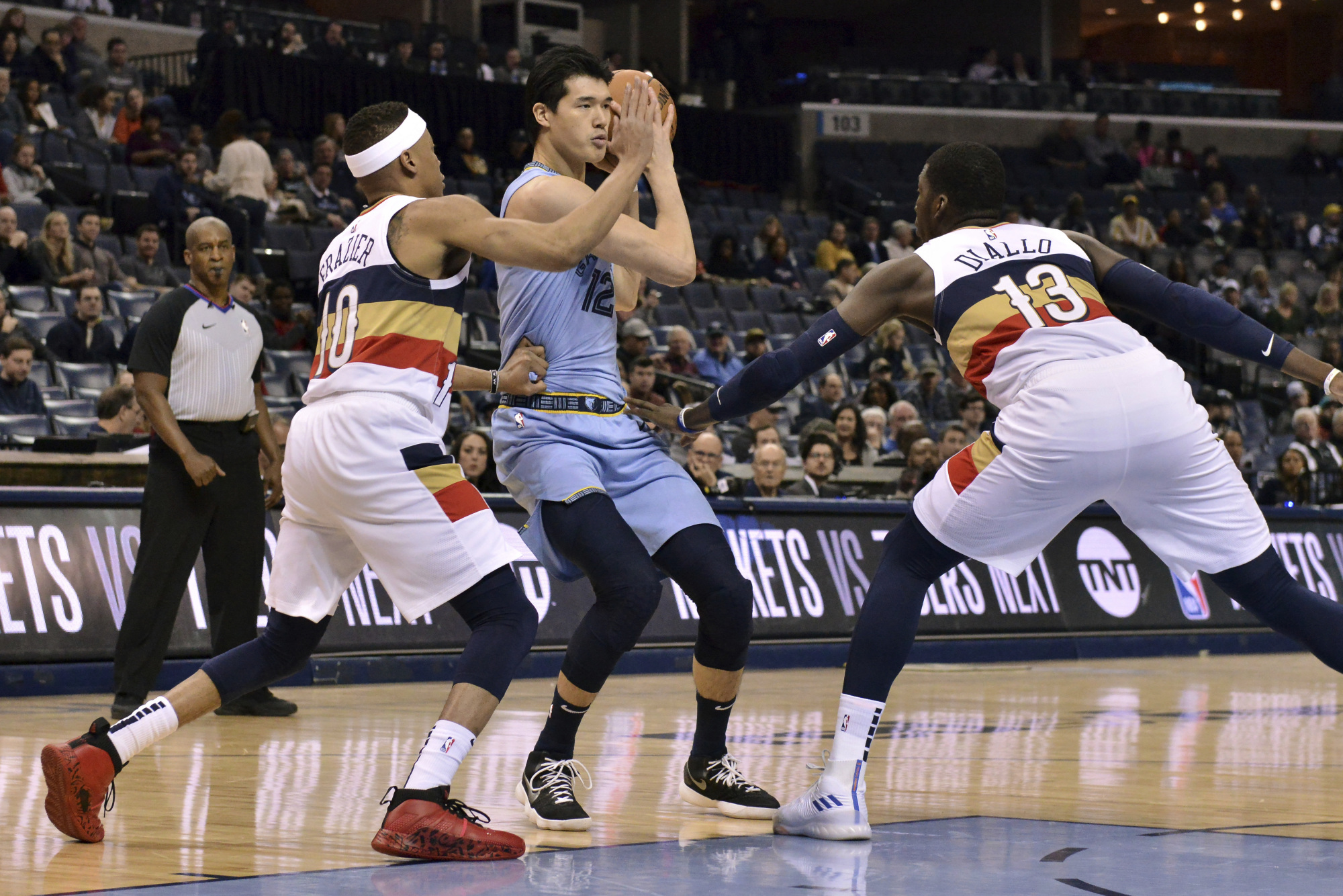 Rookie Yuta Watanabe, who is splitting time between the Memphis Grizzlies and the NBA G League's Memphis Hustle, is seen controlling the ball in the Grizzlies' game on Jan. 21 against the visiting New Orleans Pelicans. | AP
