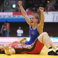 Unexpected: Russia's Valeria Zholobova celebrates after ending Saori Yoshida's 58-match winning streak on Sunday in the 55-kg final at the World Cup meet in Tokyo. | AFP-JIJI