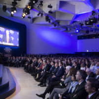 Participants listen to a special address by U.S. President Donald Trump at the World Economic Forum's annual meeting on Jan. 26, 2018.   WORLD ECONOMIC FORUM / FARUK PINJO