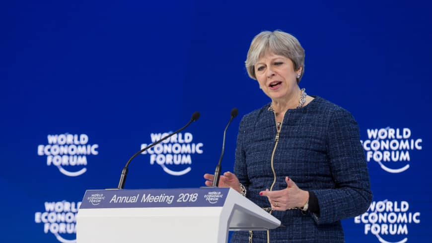 British Prime Minister Theresa May speaks at the same conference on Jan. 25, 2018. | WORLD ECONOMIC FORUM / CHRISTIAN CLAVADETSCHER