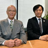 Apure Inc. President Hirosuke Takahashi (left) and NTT Docomo's Corporate Sales and Marketing Department Executive Director Masamichi Endou during an interview with The Japan Times in Tokyo on Jan. 18. | YOSHIAKI MIURA