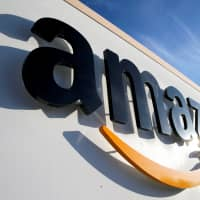 The country's antitrust watchdog launched a survey Wednesday to investigate if Amazon.com Inc. and other IT giants are harming fair competition by using their market dominance to apply unjust pressure on individual sellers and smaller vendors. | REUTERS