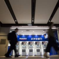 Half of Japan's regional banks to back Mizuho Bank's new cashless payment system