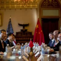 U.S. Trade Representative Robert Lighthizer (right) accompanied by Trump administration officials, meets with Chinese Vice Premier Liu He (left) and other Chinese officials for trade talks in Washington on Jan. 30. | AP