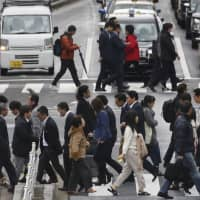 Japan's economy shows modest rebound in October-December quarter