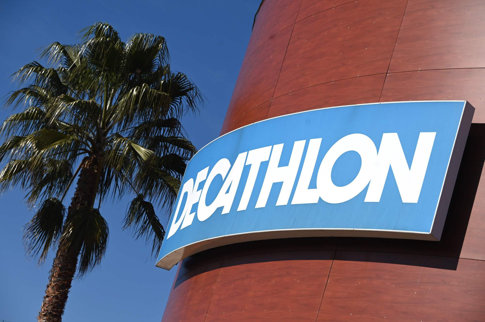 The logo at a store of French sports goods retailer Decathlon is seen Wednesday in Montpellier, southern France. | AFP-JIJI