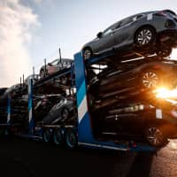 A car carrier trailer leaves the Honda car plant in Swindon, Britain, Monday.   REUTERS