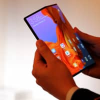 The foldable Huawei Mate X smartphone is demonstrated Saturday ahead of the Mobile World Congress in Barcelona, Spain.   REUTERS
