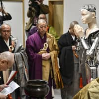 A robot modeled after Kannon Bodhisattva is unveiled to the media at Kodaiji Temple in the city of Kyoto on Saturday. | KYODO