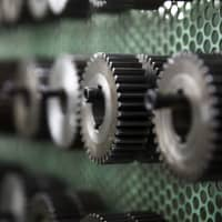 Tools for manufacturing gears are seen on the production line at Kohara Gear Industry Co.'s factory in Kawaguchi, Saitama Prefecture, on Feb. 12. The month-on-month pace of the nation's industrial output's decline in January is the biggest in a year.   BLOOMBERG