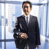 Masumi Minegishi, president and CEO of Recruit Holdings Co., at the company's headquarters in Tokyo last year | BLOOMBERG