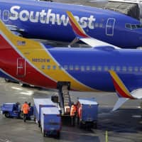 Southwest Airlines planes are loaded at Seattle-Tacoma International Airport in Seattle Feb. 5. Federal officials have told Southwest to fix the way it calculates the weight of luggage loaded on flights after finding frequent mistakes. | AP