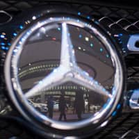 People are reflected on a Mercedes-Benz model during the press preview at the 2018 North American International Auto Show (NAIAS) in Detroit last year.  The White House on Monday received a Commerce Department report on the auto industry that could trigger tariffs against imported cars and intensify tensions, particularly with Europe.   AFP-JIJI