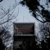 Toshiba cuts fiscal 2018 profit outlook on sluggish semiconductor sector
