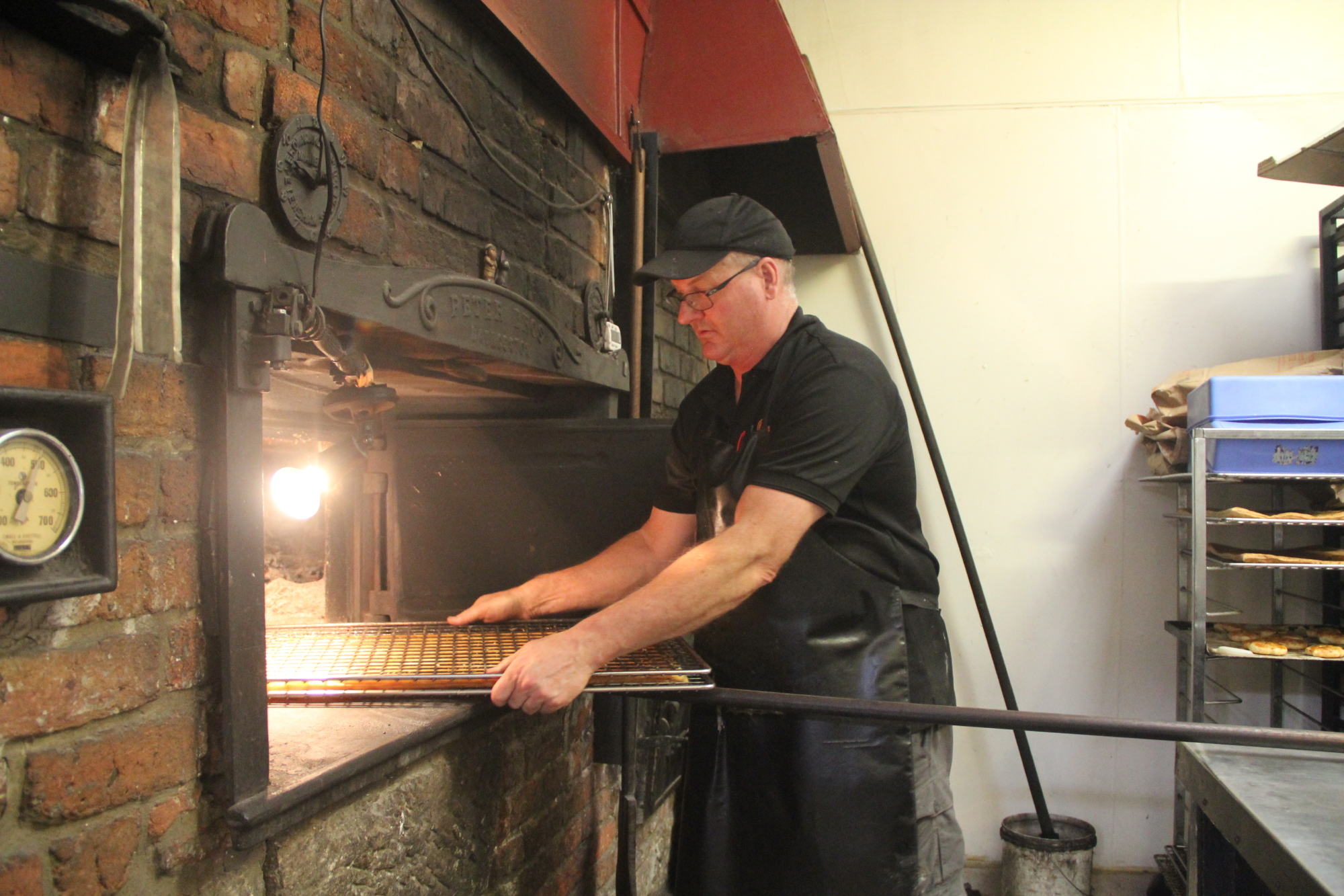 A toasty treat: Bakery owner Carl Crosby attends to pastry in the Ross Village Bakery