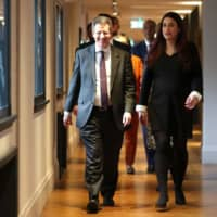 Former Labour party MPs Chris Leslie and Luciana Berger arrive for a news conference in London on Monday where they and colleagues announced their resignation from the Labour Party and the formation of a new independent group of lawmakers. | AFP-JIJI