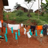 Disinfected health care workers' gear dry in a hospital in Bwana Suri, Ituri province, Congo, in December. | REUTERS